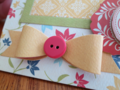 Chipboard Mini Albums - Family Traditions yellow bow closeup