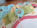 Chipboard Mini Albums - Family Traditions green bow closeup
